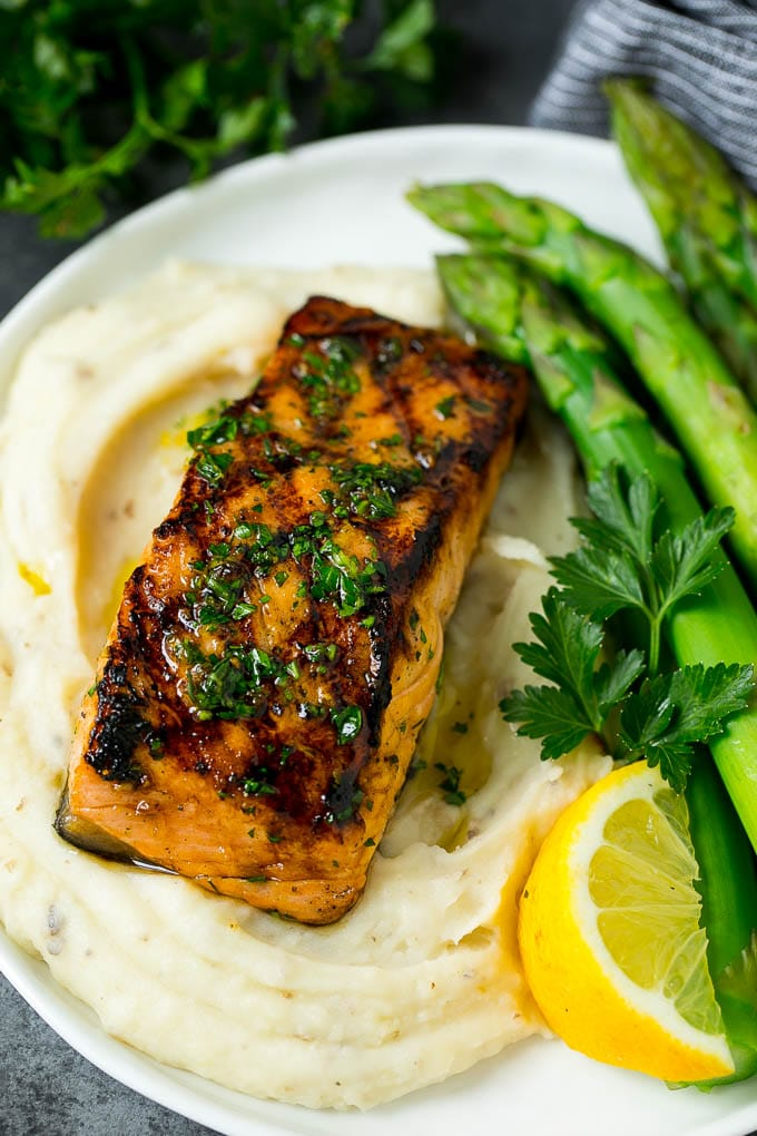 A grilled salmon fillet served with mashed potatoes and asparagus.