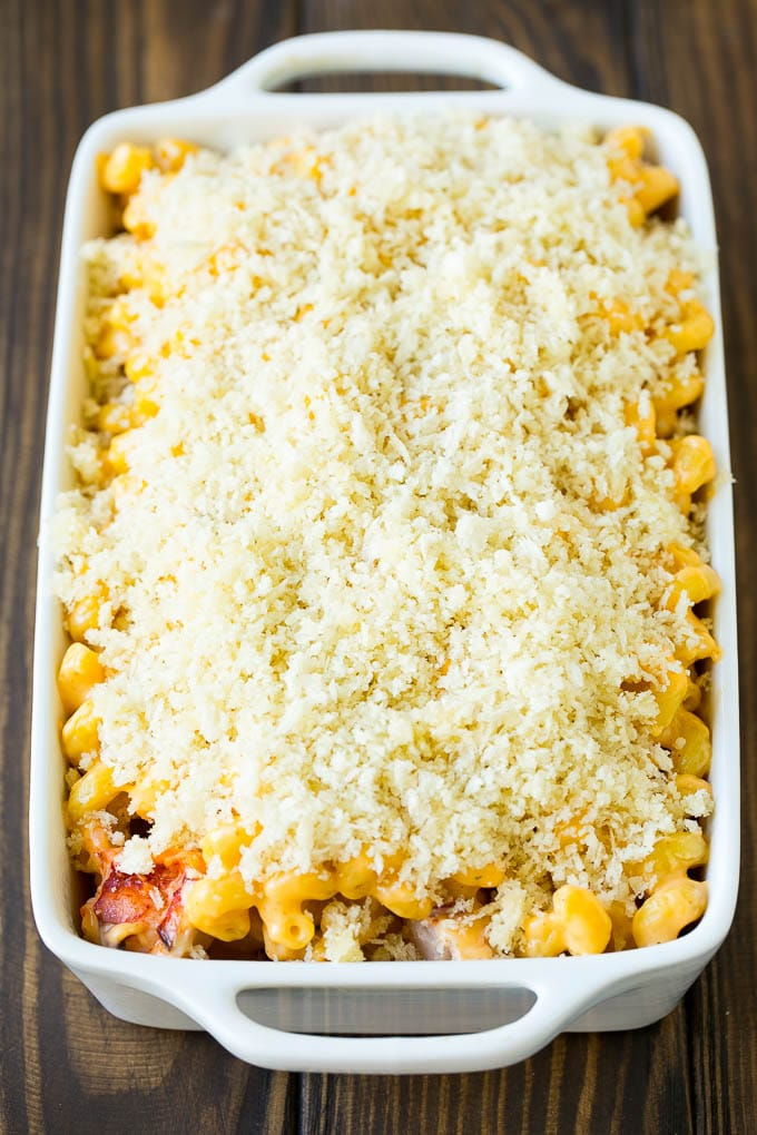 A casserole dish of lobster mac and cheese topped with panko breadcrumbs.