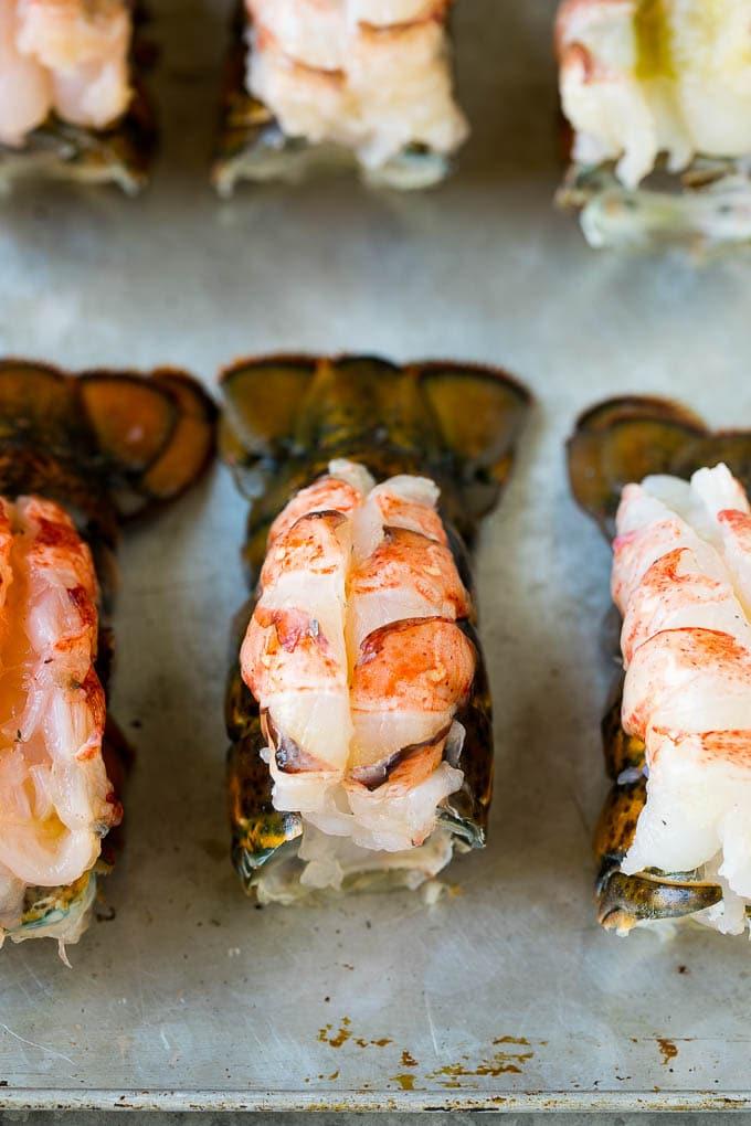 Lobster meat butterflied on top of lobster shells.