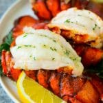 Broiled lobster tails topped with garlic butter.
