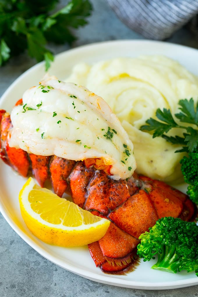 A lobster tail served with mashed potatoes and broccoli.