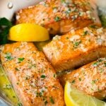 Pan seared salmon fillets in garlic butter sauce.