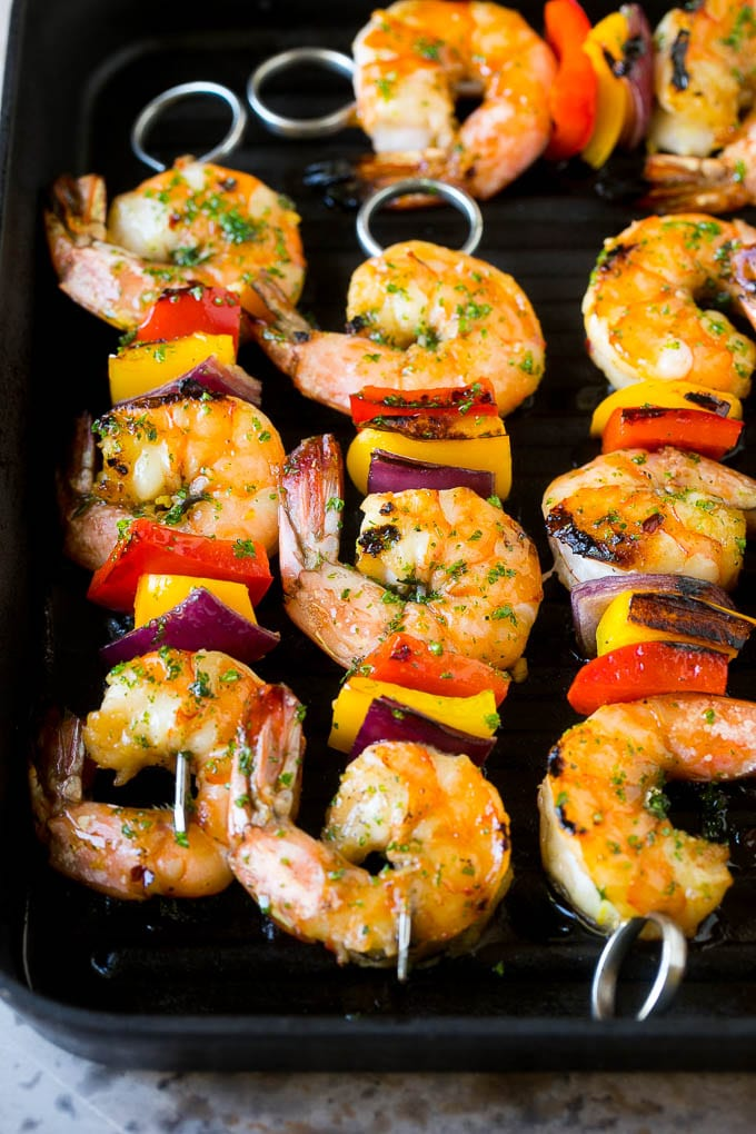 Shrimp skewers on a grill pan.