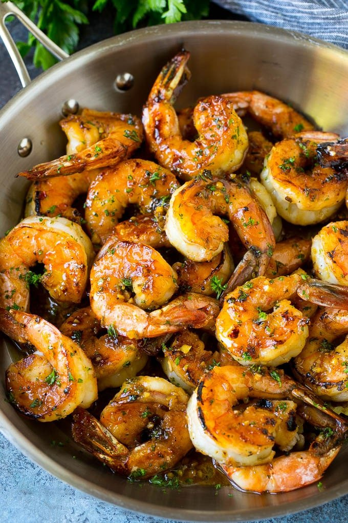 A pan of marinated shrimp that have been sauteed until brown.