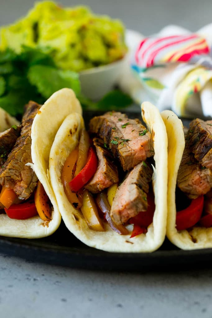 Tortillas filled with steak and sauteed peppers and onions.