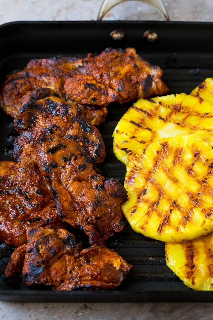 Grilled pork and pineapple on a pan.