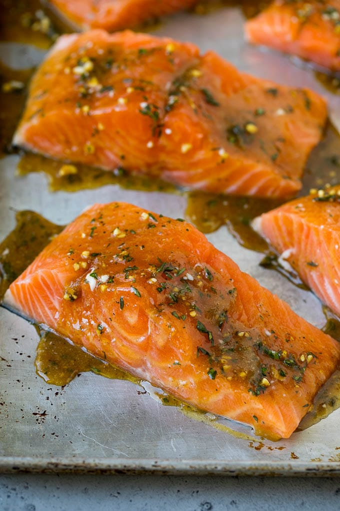 Raw salmon coated in a mixture of butter, garlic and herbs.