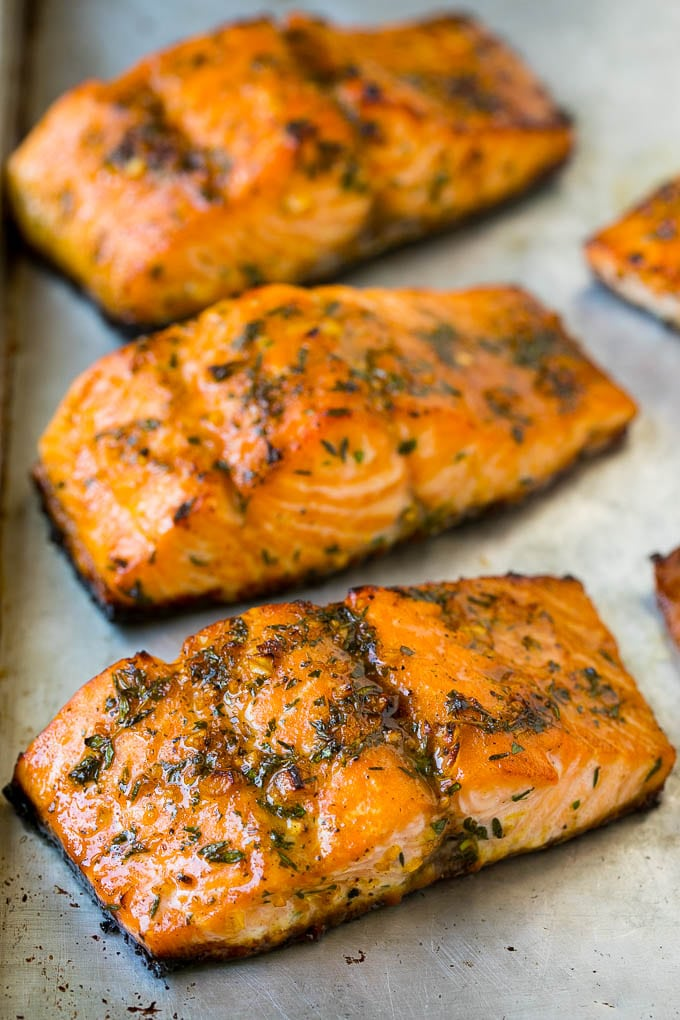 Roasted salmon topped with garlic and herbs.