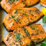 Baked salmon topped with garlic, herbs and butter.