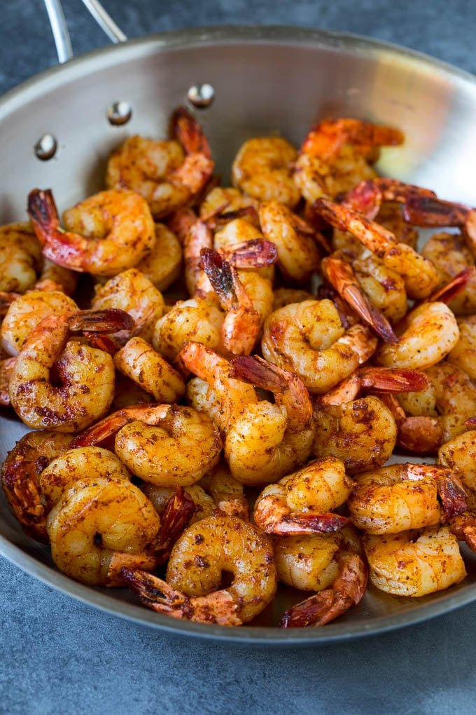 Seared shrimp in a skillet.