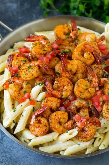 Cajun shrimp pasta with spiced shrimp, creamy sauce and tomatoes.