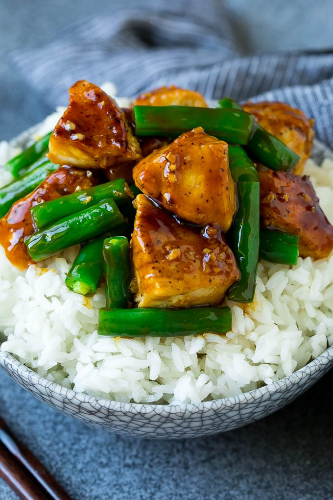 Chicken and green bean stir fry served over rice.