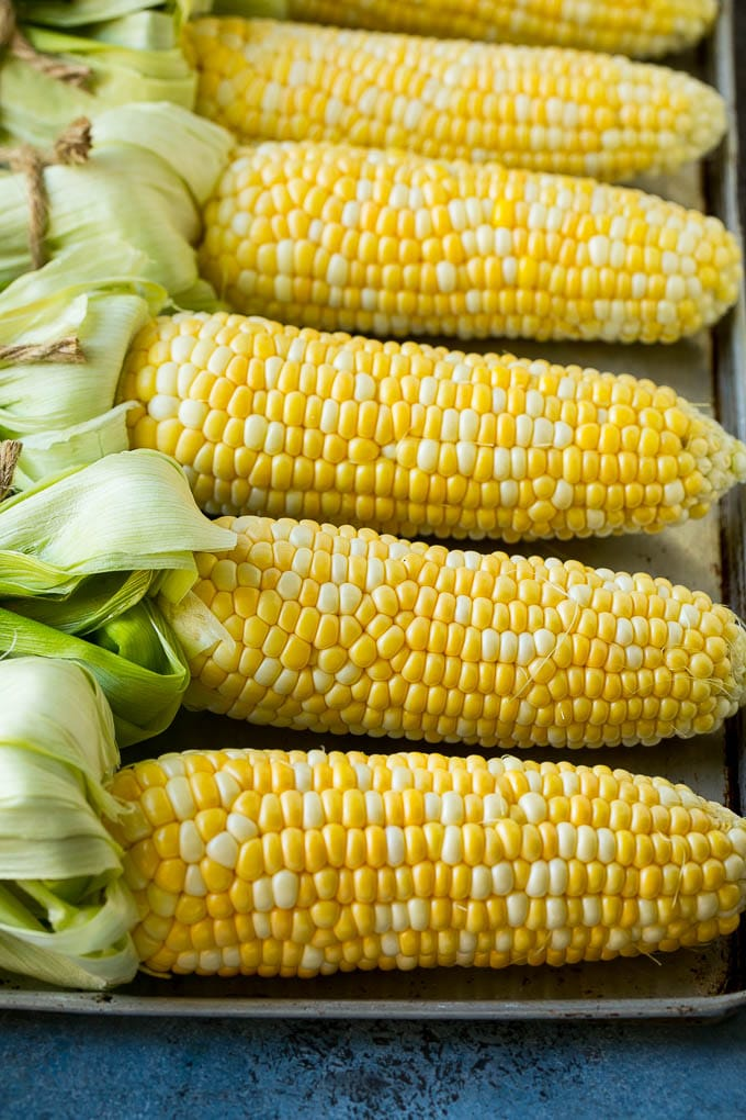 Corn cobs on a sheet pan.