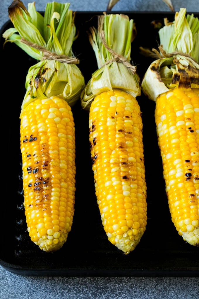 Corn cooking on a grill pan.