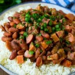 Red beans and rice with sausage, ham and vegetables, topped with herbs.