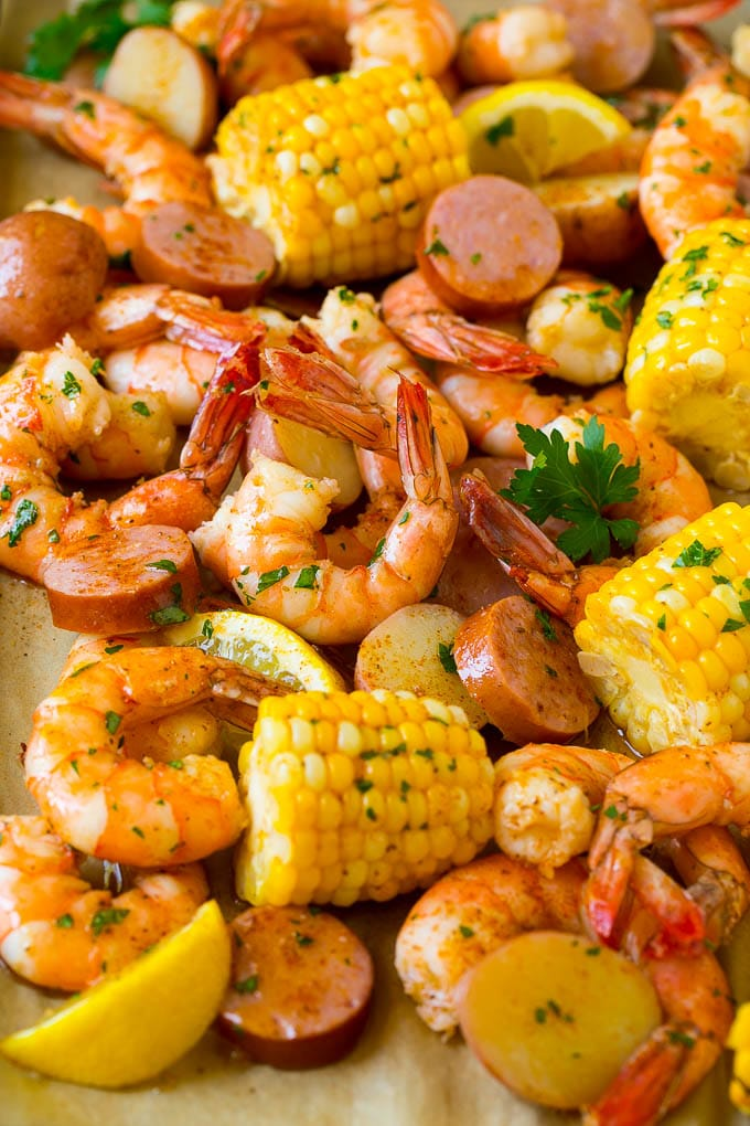 Shrimp boil with tender shrimp, corn on the cob, potatoes and sausage.