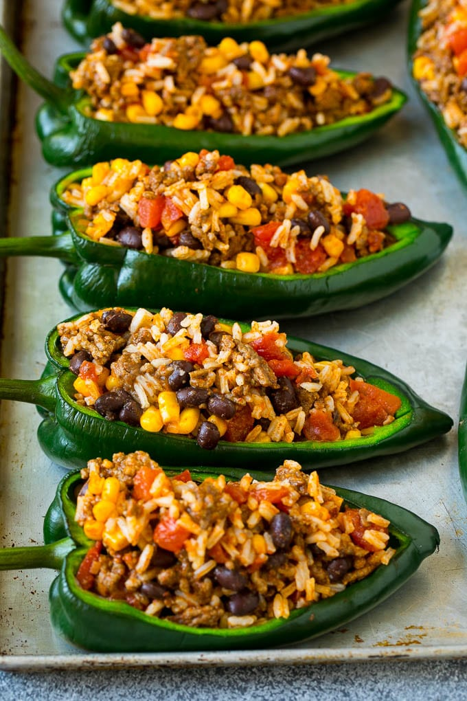 Poblano peppers filled with rice, meat, beans and corn.