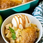 Apple cobbler served with vanilla ice cream and caramel sauce.