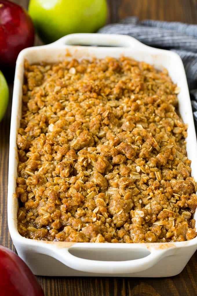 A baked apple crisp with an oatmeal and walnut topping.