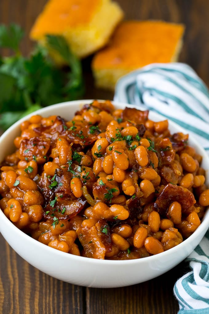 A bowl of baked beans made with bacon and brown sugar sauce.
