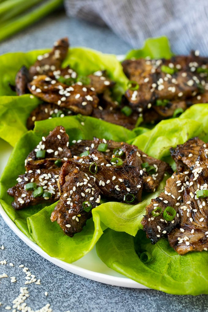 Lettuce cups filled with beef bulgogi and green onions.
