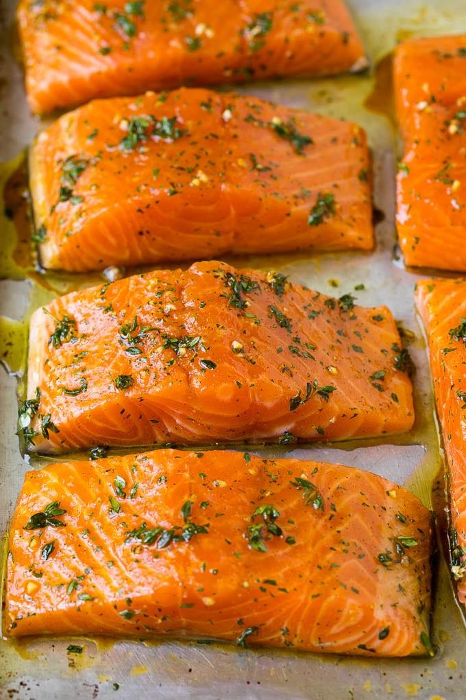 Salmon fillets on a sheet pan.