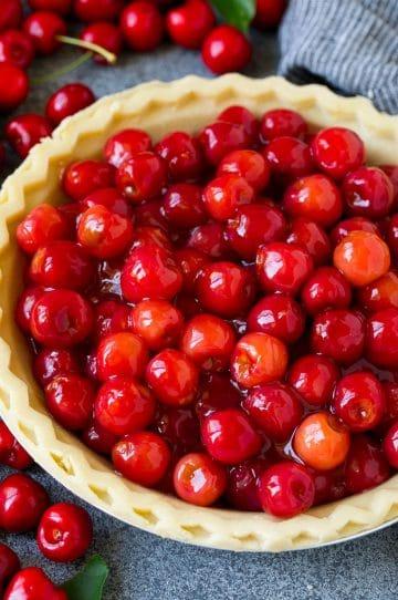 Cherry pie filling inside of an unbaked pie crust.