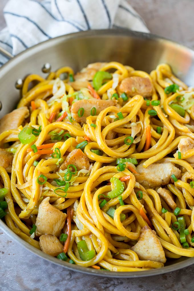 A pan of chicken and vegetable lo mein.