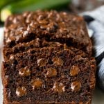 Sliced chocolate zucchini bread filled with melted chocolate.