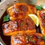 Honey glazed salmon garnished with parsley and lemon.