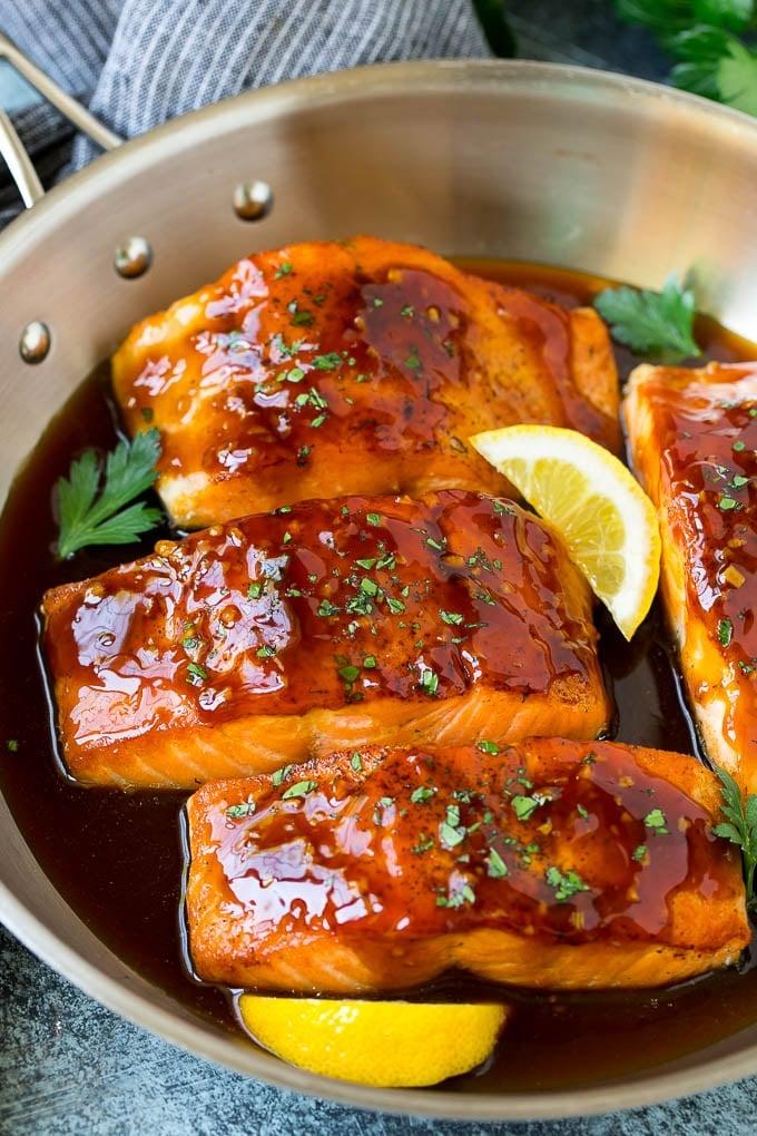 Honey glazed salmon garnished with parsley and lemon.