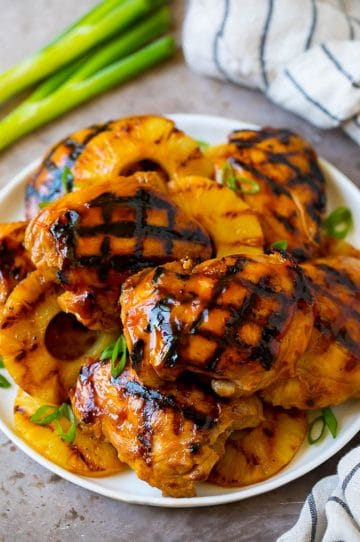 A plate full of huli huli chicken and grilled pineapple.