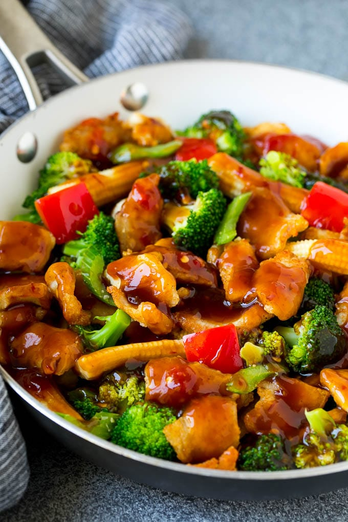 Hunan chicken with vegetables in a savory sauce.