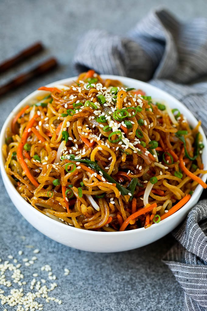 Pan fried noodles in a serving bowl.