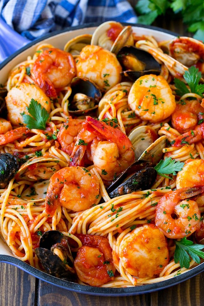 A skillet of seafood pasta with spaghetti, shrimp and shellfish.