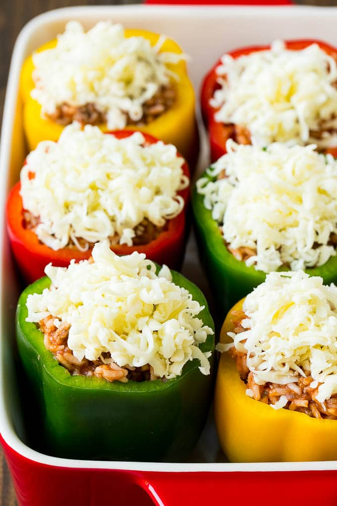 Bell peppers filled with meat and rice, then topped with shredded cheese.