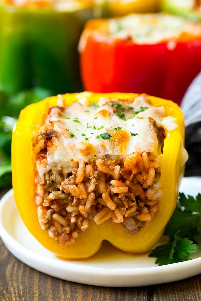 A stuffed bell pepper cut open on a plate.