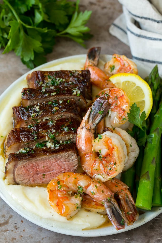 Surf and turf with steak, shrimp, mashed potatoes and asparagus.