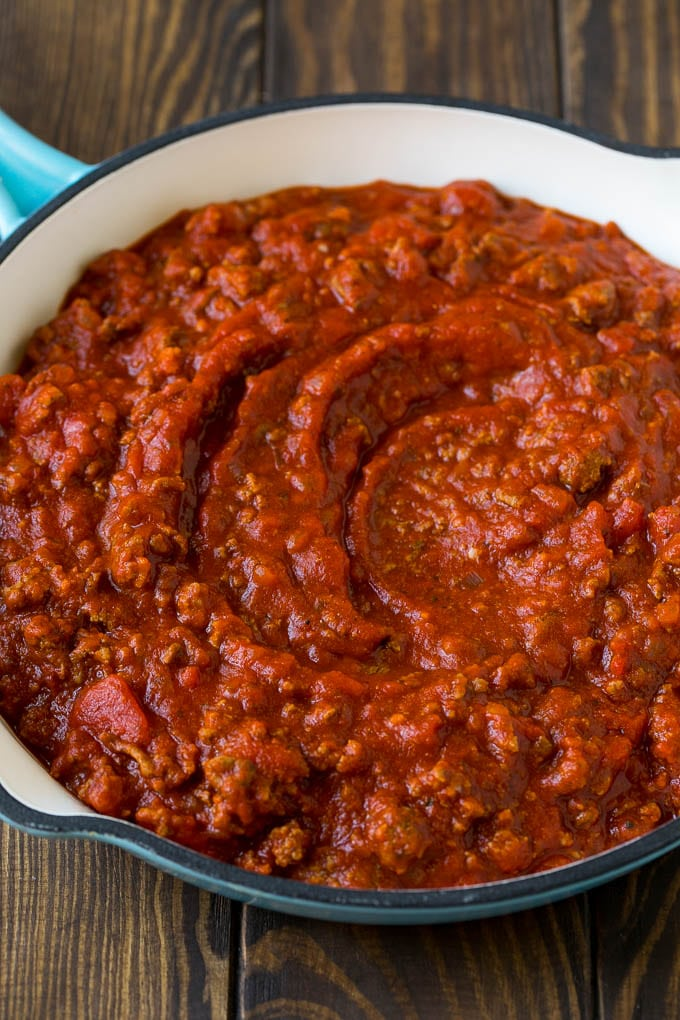Meat sauce with ground beef and tomatoes in a skillet.