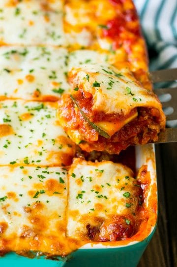 A spatula serving up a portion of zucchini lasagna.