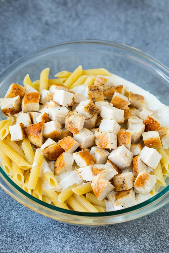 Chicken, pasta and creamy sauce in a bowl.