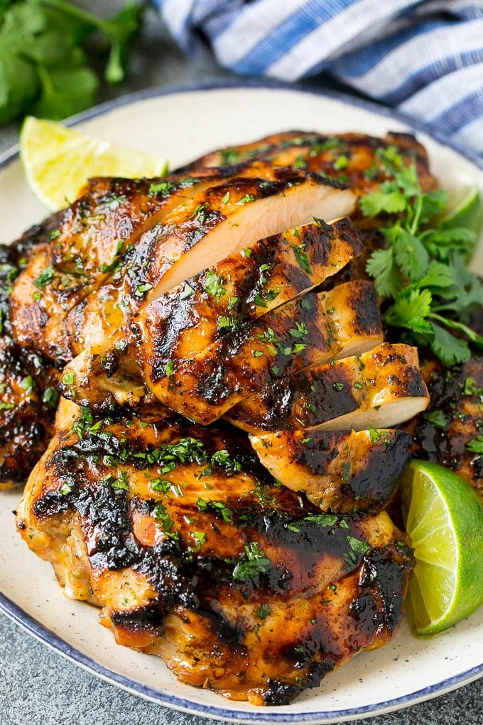 Sliced grilled chicken thighs with cilantro and lime flavoring.