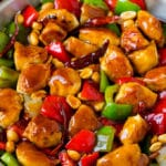 Kung pao chicken with seared chicken breast, bell peppers and peanuts in a savory sauce.