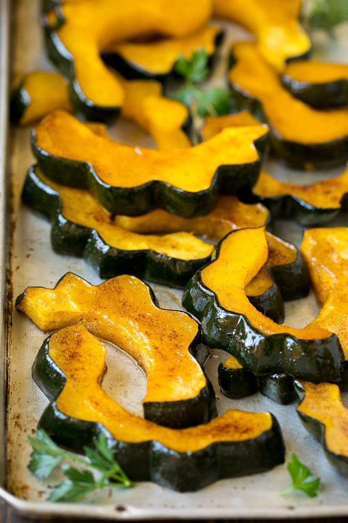 Roasted acorn squash garnished with fresh parsley.