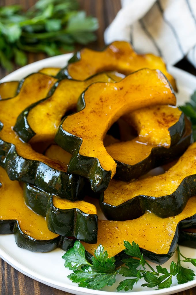 A serving plate of roasted acorn squash.