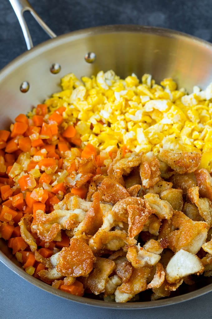 Thinly sliced cooked chicken with carrots and scrambled eggs.