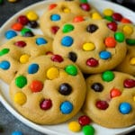 A plate of M&M cookies, garnished with extra candy.