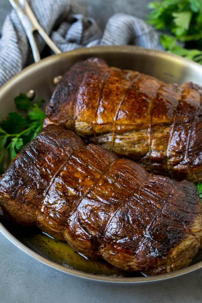 Roasted garlic butter beef tenderloin in a pan.