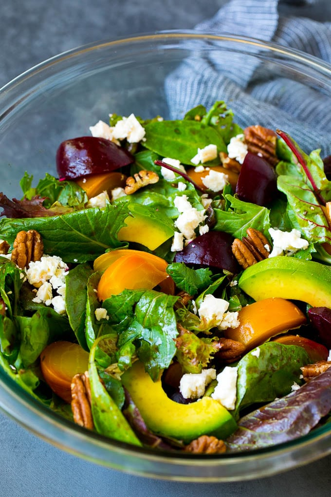 Beet salad with mixed greens, feta cheese and avocado.