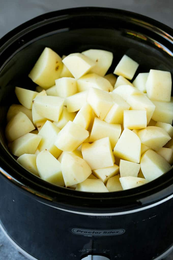 Diced, peeled potatoes in a slow cooker.